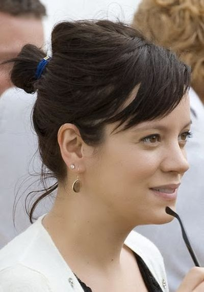 Lily Allen Dark Brown Hair Colored and Straight Bun Hairstyle