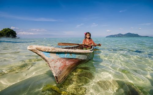 Village girl ridding on boat this is beautiful boat wallpaper