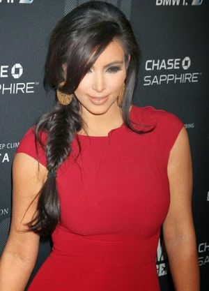 Kim Kardashian Wavy and Bangs with Braided Hairstyle