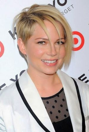 Michelle Williams Golden Hair and Side Swept Hairstyle