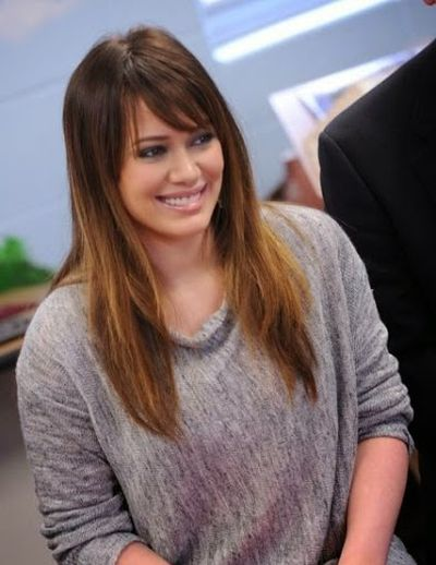 Hilary Duff Cool Looking and Cute Smile with Straight Hair and Left Side Swept Bangs Hair Look