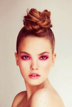 Dark Pink Colored Eye Makeup with Medium Size Messy Bun Hairstyles