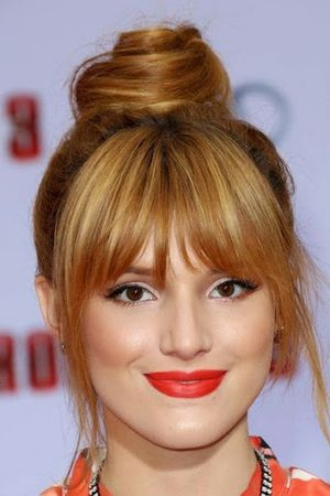Bella Thorne Straight Curved Bangs with Bun Hairstyle