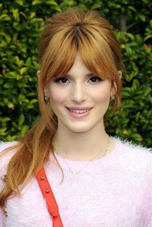 Bella Thorne Golden Blonde Hair with Bangs Hairstyle