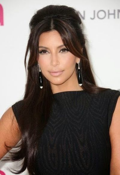 9. Kim Kardashian Shiny and Straight with Bangs Hair Look