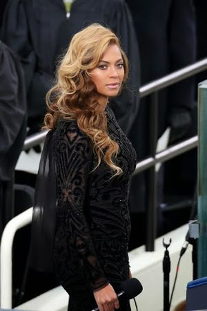 Beyonce Styles Black Dress With Wavy and Curls Hairstyle