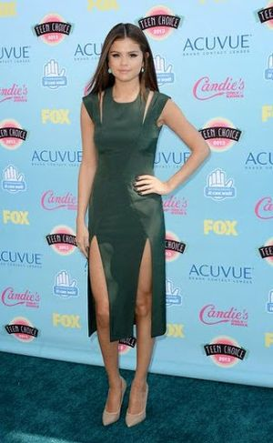 Selena Gomez Green Outcut Dress and Long Straight Hairstyle
